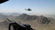 Stock Video Footage of Super Huey flying over Afghanistan (HD) c