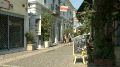 Athens street in the Placa with motor bike Stock Footage
