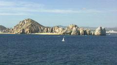 Baja sailboat off lands end Stock Footage