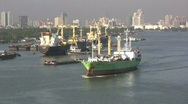 Bangkok Chao Phraya River freighter  Stock Footage