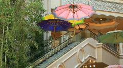 Escalator under umbrellas P HD 6927 Stock Footage