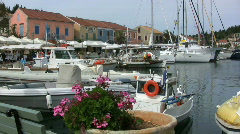 Greece Sailboats and flowers Fiscardo on Kefalonia Stock Footage