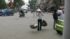 Hanoi woman with baskets Stock Footage