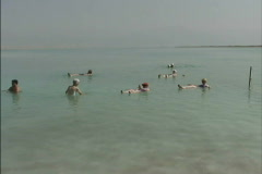 Israel Tourists floating in Dead Sea Stock Footage