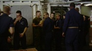 Sailors form line loading supplies  (HD) c Stock Footage
