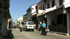 Malacca Chinatown street with motor bikes Stock Footage