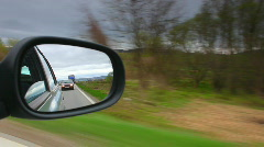 Car driving and stop looking through mirror Stock Footage