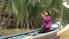 Vietnamese paddling canoes  Stock Footage
