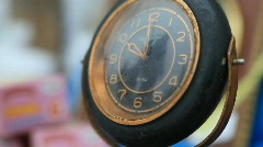 Vintage clock reflecting people  Stock Footage