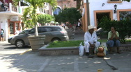 Stock Video Footage of Mexico Puerto Vallarta men by curb