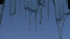 Icicles against a blue sky Stock Footage