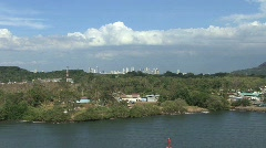 Panama Canal Simple dwellings and distant city Stock Footage