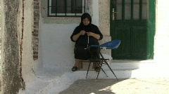 Prigi village Chios woman sewing Stock Footage