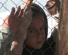 Little Girl Behind Fence of Refugee Camp in Swat Pakistan - stock footage