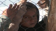 Stock Video Footage of Little Girl Behind Fence of Refugee Camp in Swat Pakistan