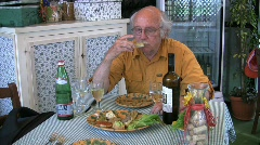 Italy Latium Man eating lunch at Vulci Stock Footage