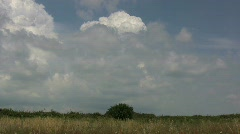 Clouds over a grassland Stock Footage