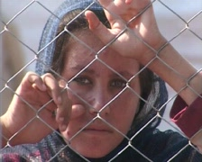Girl Behind Fence of Refugee Camp in Swat, Pakistan Stock Footage