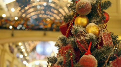 Artificial tree decorated with spheres and beads in shopping centre Stock Footage