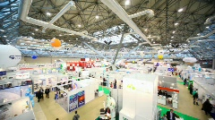 Review from left to right hall with people and exhibition pavilions - stock footage