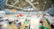 Review from left to right hall with people and exhibition pavilions Stock Footage