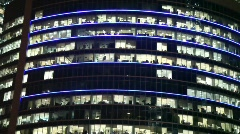 Building at night decorated with strips changing colour Stock Footage