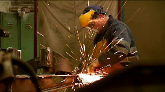 Worker grinding a steel  in a factory - stock footage
