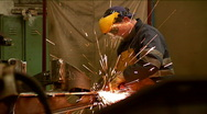 Worker grinding a steel  in a factory Stock Footage
