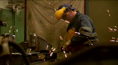 Worker grinding a steel  in a factory slow motion - stock footage