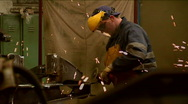 Worker grinding a steel  in a factory slow motion Stock Footage