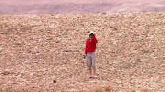 Weird fisherman in the desert 6 Stock Footage