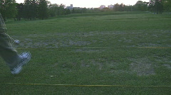 Teeing up at driving range in setting sun Stock Footage