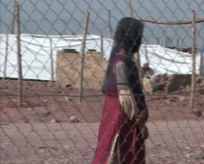 Girl Behind Fence of Refugee Camp in Swat, Pakistan - stock footage