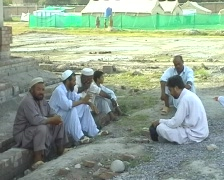 Men Outside Refugee Camp in Swat; Pakistan Stock Footage