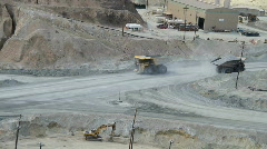 ore carrying dump trucks - stock footage