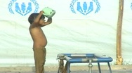 Stock Video Footage of Young Boy Bathing in a Refugee Camp in Swat, Pakistan