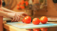 Young woman cooking vegetables. Fast motion effect. - stock footage