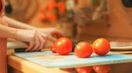 Stock Video Footage of Young woman cooking vegetables. Fast motion effect.