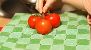 Stock Video Footage of Young woman drying vegetables