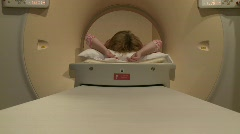 MRI table move toward camera with woman Stock Footage