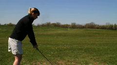 woman drives golf ball - stock footage