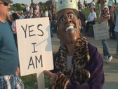 Stock Video Footage of Anti Obama Tea Party Demonstrator with  Black Mask & Cigarette