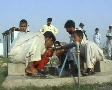Men Washing Feet at Refugee Camp in Swat, Pakistan Footage