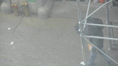 Man braves snowstorm with umbrella Stock Footage