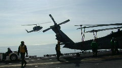 Huey Helicopter lands on ship (HD) c - stock footage