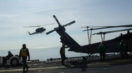 Huey Helicopter lands on ship (HD) c Stock Footage