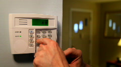 Man Arms Home Security System with Keypad on Wall - stock footage