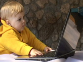 Baby with laptop Stock Footage