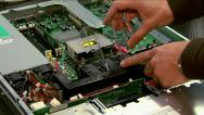 Stock Video Footage of Engineer compiles parts of a computer