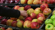 Woman Selecting Apples In Produce Stock Footage